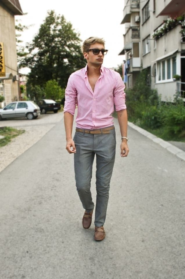 Pink shirts, gray pants, and brown accessories make for a good ...