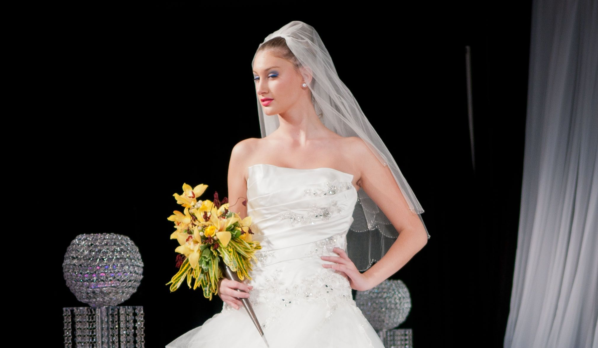 Bride with beautiful yellow orchid bouquet.