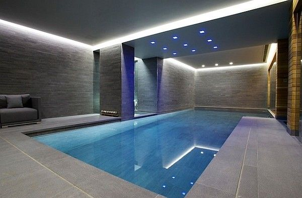 Grey Walls And Recessed Lighting Give This Indoor Pool A Minimalist Appeal Decoist Indoor Pool Design Modern Pools Luxury Swimming Pools
