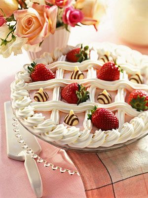 """Checkerboard Strawberry Pie: Beneath the strawberry and whipped topping checkerboard, you'll discover white chocolate cream pie filling and chopped strawberries""."