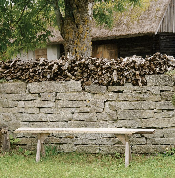 Kindling stacked on a stone wall