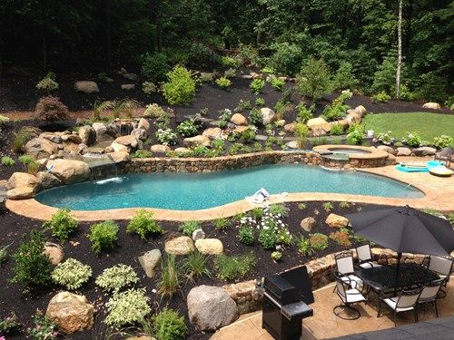 sloped backyard with a pool, aqua outdoor environments in acton