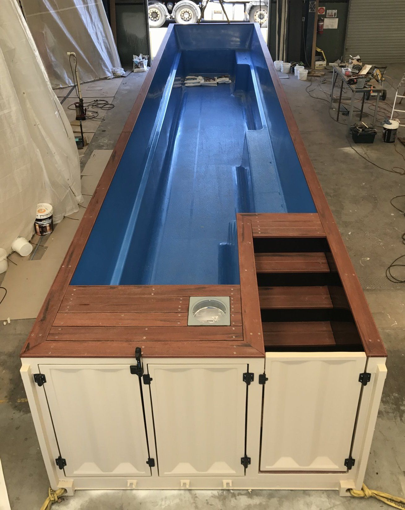 converting a shipping container into a swimming pool seems like a cheap way of keeping cool this. Black Bedroom Furniture Sets. Home Design Ideas