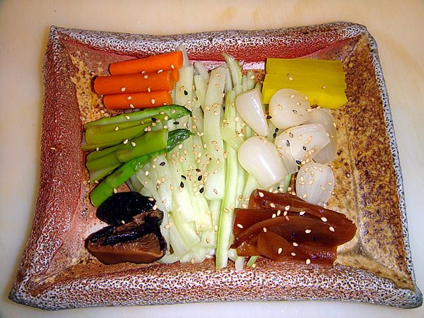 Sake Sushi Bar and Grill...Oshinko (Japanese Pickled Vegetables). This appetizer rocks...the radishes & shiitakes are the best. Not every sushi bar has this as an appetizer...so that is a major plus. All of the pickled veg are great when lightly dipped in soy sauce.