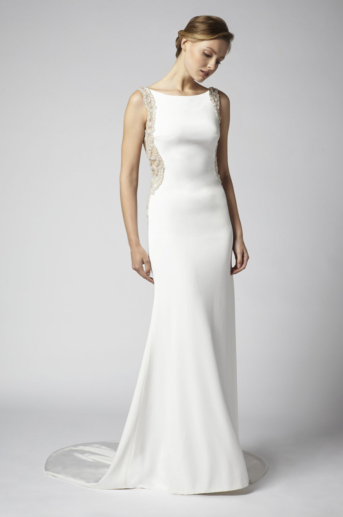 Simple sheath wedding dress with open back and beaded embellishments