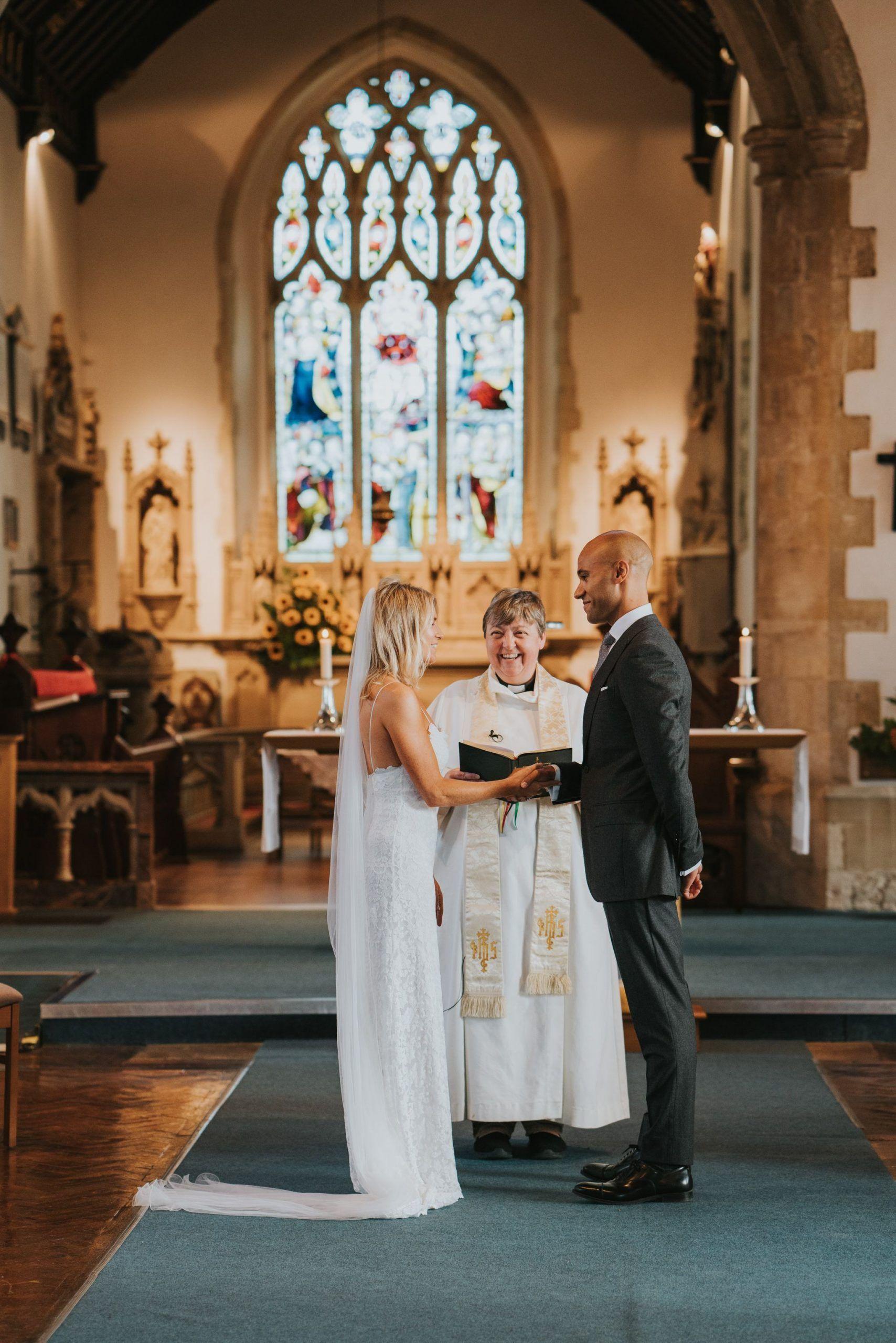 Christian wedding in natural light church. Catholic