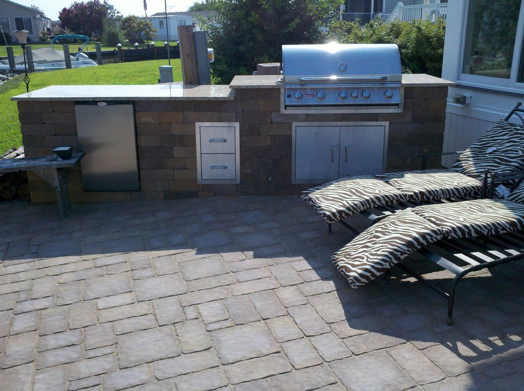 Your Cambridge Outdoor Kitchen Can Have A Built In Refrigerator And Stainless Steel Cabinets Outdoor Grill Island Outdoor Living Outdoor Kitchen Cabinets