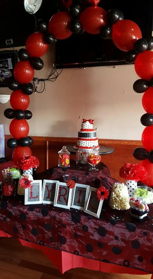 ladybug baby showerred and black cake and candy table