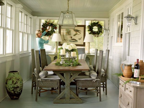 This porch-turned-dining room is effortlessly chic. Wicker chairs ...