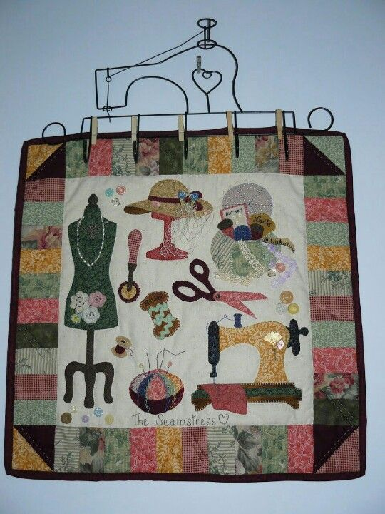 Sewing room wall hanging. I want to make the wire hanger and hang my own sewing art from it.