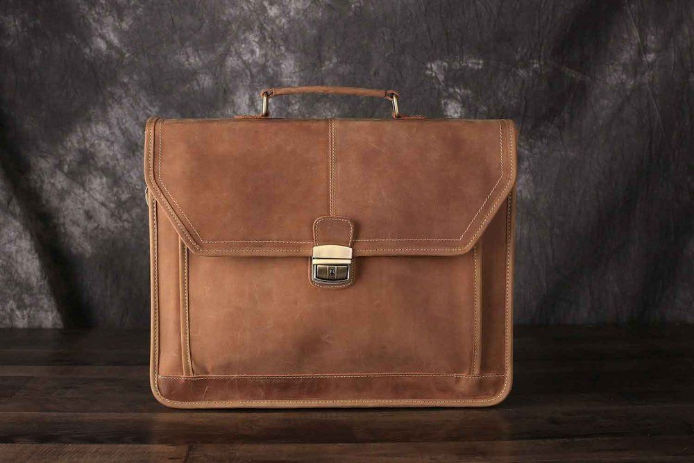 eddb68d64e0a Kelby Laptop Leather Briefcase for Men. This leather briefcase is crafted  from selected thick full grain cow leather. This bag combines great looks  with ...