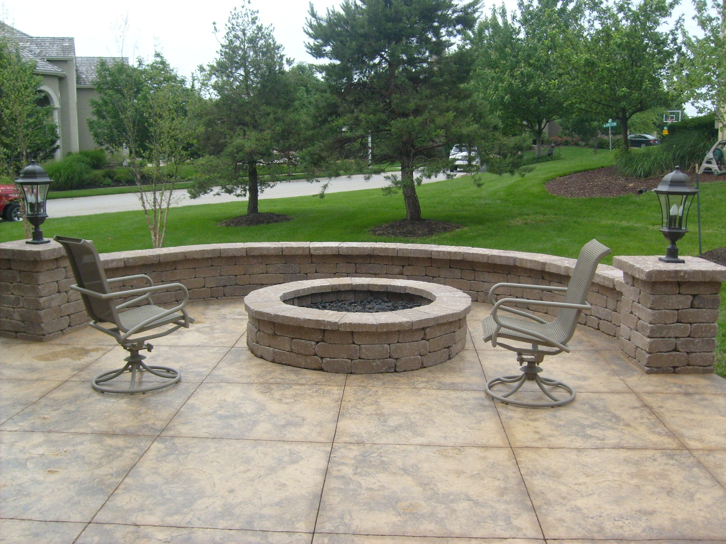 Stamped Concrete Patio With Seating Retaining Wall And Firepit Concrete Patio Paver Patio Diy Concrete Patio