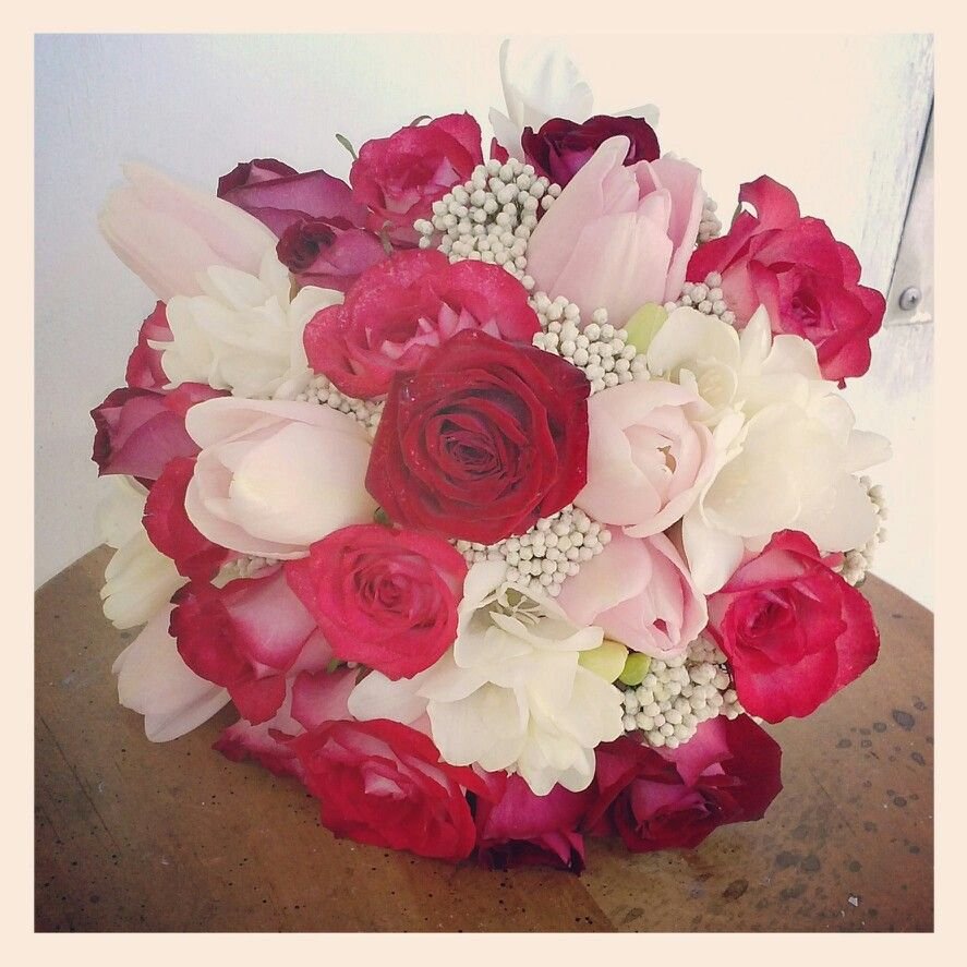 Wedding bouquets red and white roses  A red pink and white wedding bouquet of fire and ice roses tulips