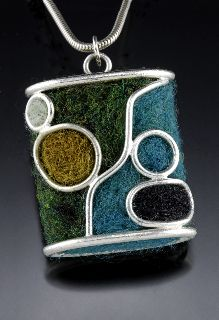 Thea Clark will host two classes at SCC this March: Felt and Metal: Strategies for 2d and 3d Jewelry, and Felt and Metal: Beads and Earrings. Learn to create structurally sound metalwork and hard, well-made felt. Shape wool roving into beads using needle felting techniques, lay down color, lines and other surface treatments, and wet felt beads. Or cover sawing, drilling, dapping, and wire-forming metal techniques to create earrings with metal end caps and French hooks.