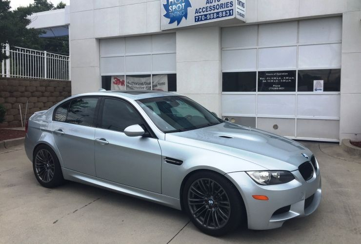 BMW M5 with silver paint and dark tinted windows using 3M