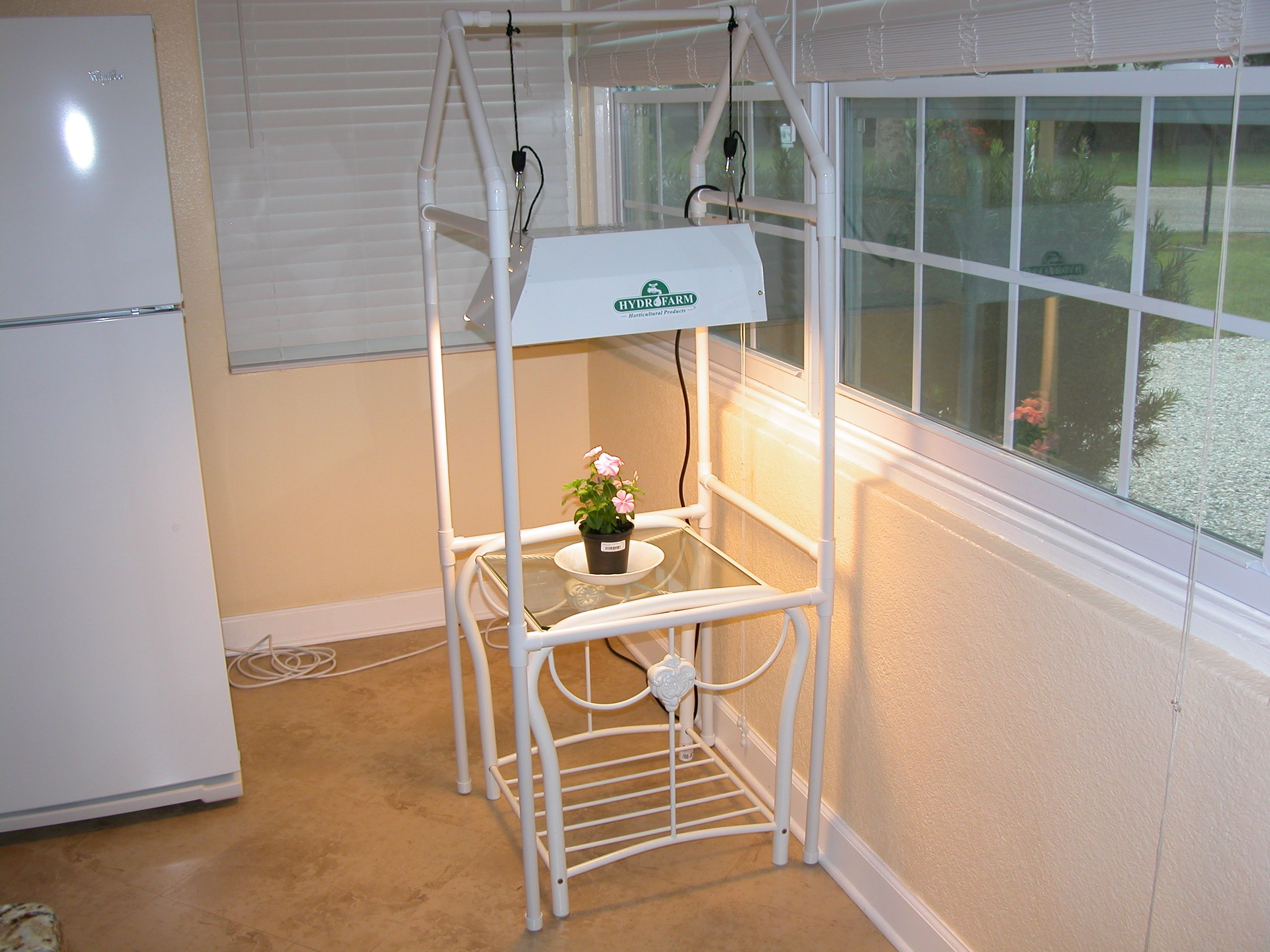 Pvc light stand my green thumb pinterest pvc projects pvc how to build a do it yourself pvc grow light pland stand with pictures solutioingenieria Choice Image