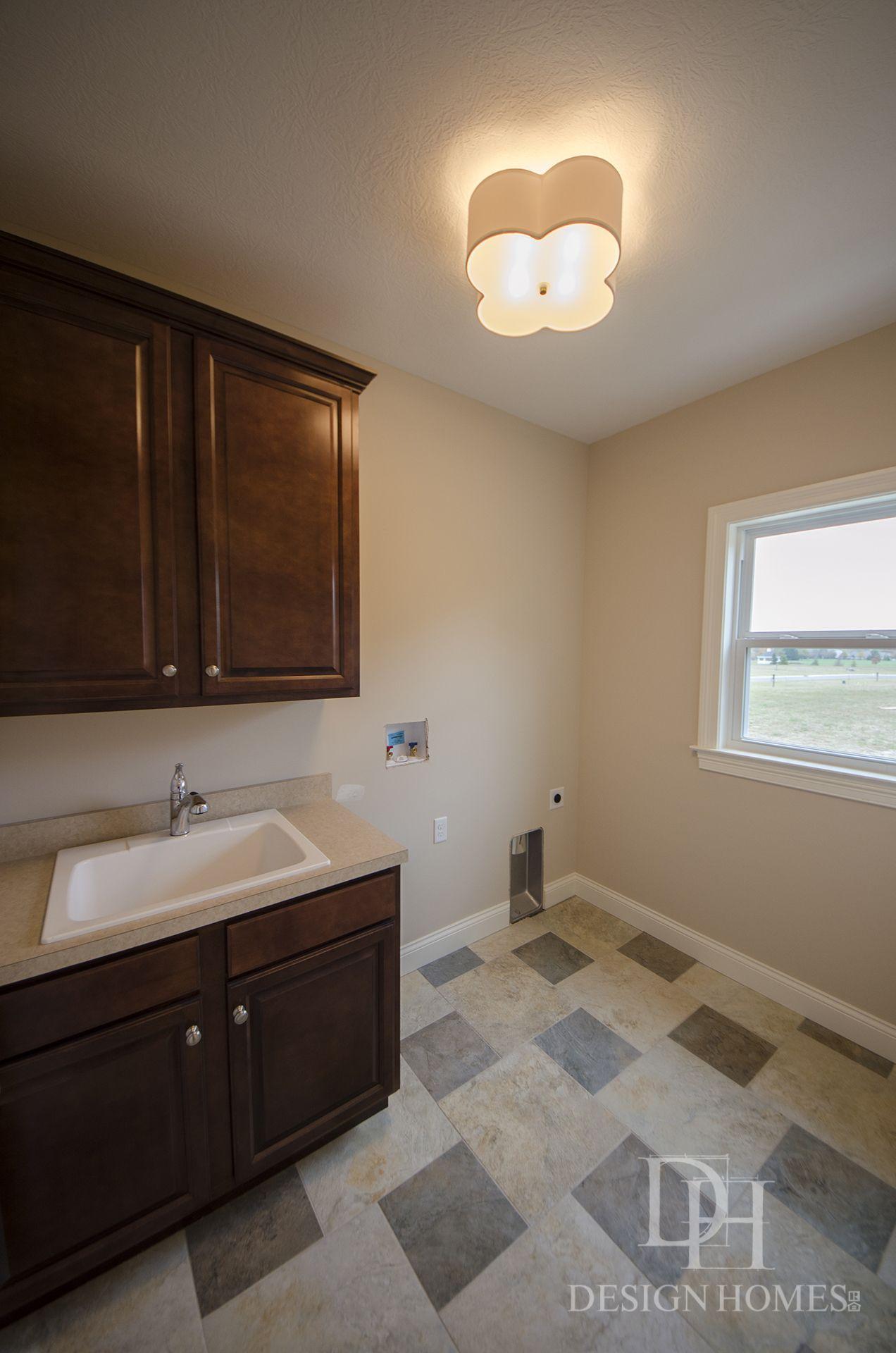 Custom built utilities room by Design Homes & Development Co ...