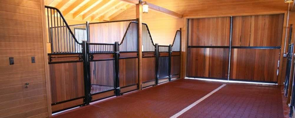 Horse Stall Design Ideas european horse stall fronts with swing gates mounted on block walls Horse Barn Interior Trilogy Barn And Stable Company Stable And Indoor Arena Designs