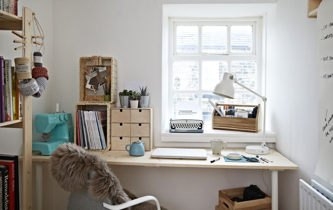 A White Home Office With Desk And Office Chair.