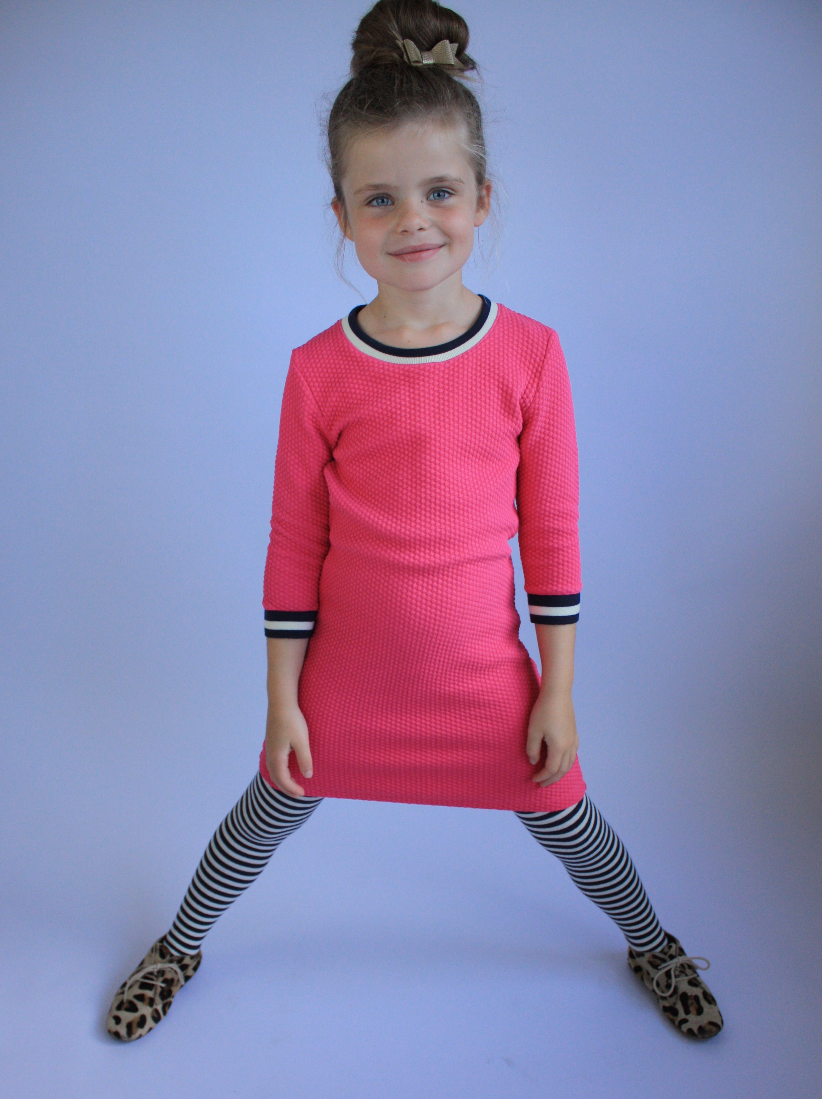Pink is still her favorite color. Wearing a pink dress from the Dutch brand Br@nd for girls and Maruti leopard shoes.