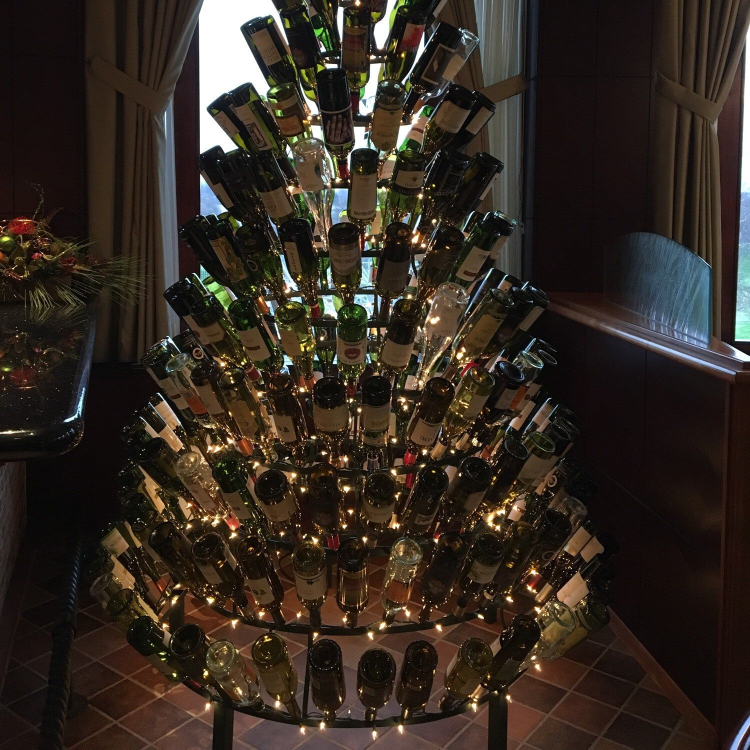 One Of Our Wine Bottle Trees Proudly Placed Beside The