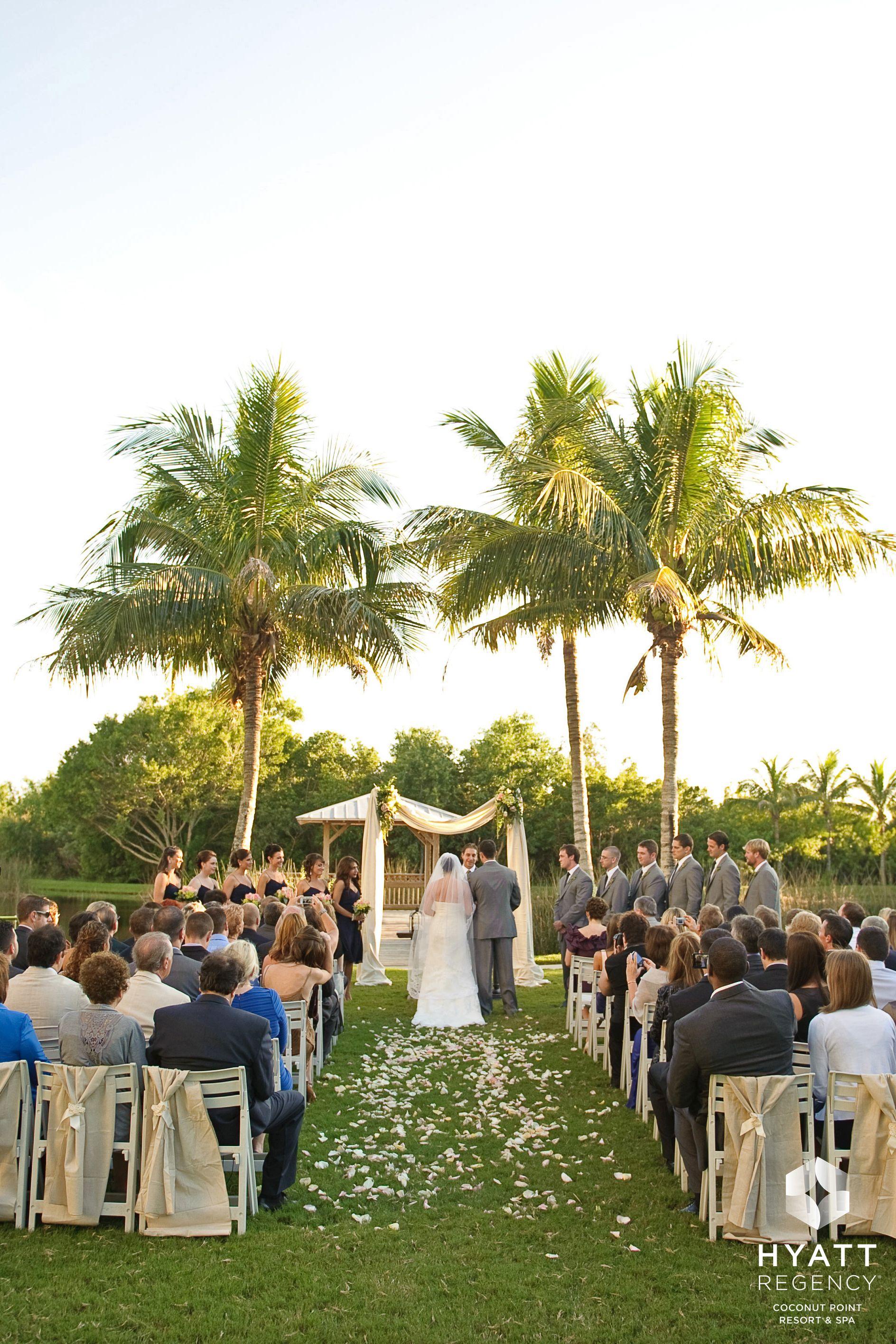 Tropical outdoor wedding on Cypress Courtyard Hyatt Regency Coconut