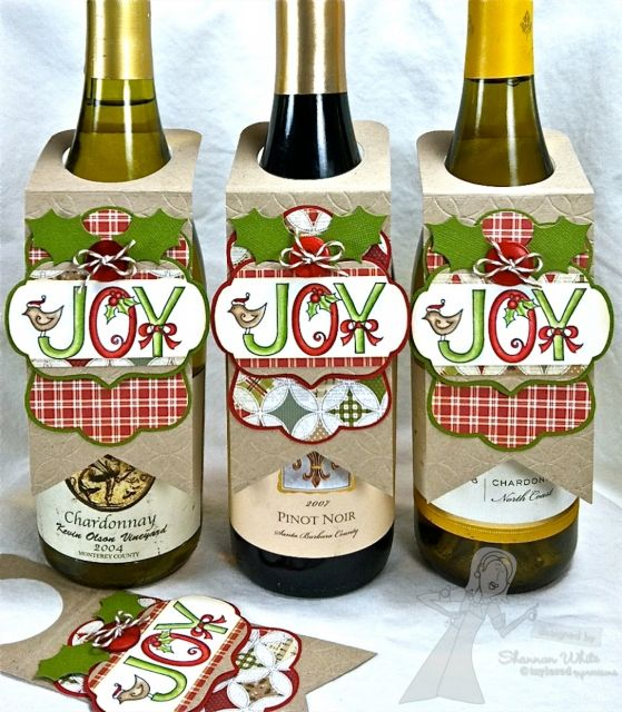 Joy Wine Bottle Tags By Shannon White Taylored Expressions Stamps: Joy a la Carte (TE) Ink: Memento Tuxedo Black, Antique Linen Distress ink Paper: Handmade Holidays (Simple Stories), Kraft CS, Choice Butter Cream CS (TE) Bazzill Accessories: Label Stacklets 1, Frame It Up 1, Very Merry Outlines Dies, Scallops  Circles Impression Plate, Waves  Bubbles Impression Plate2 Die (TE) Classic Circles (SB)foam tape, buttons, Doodle twine, Copics