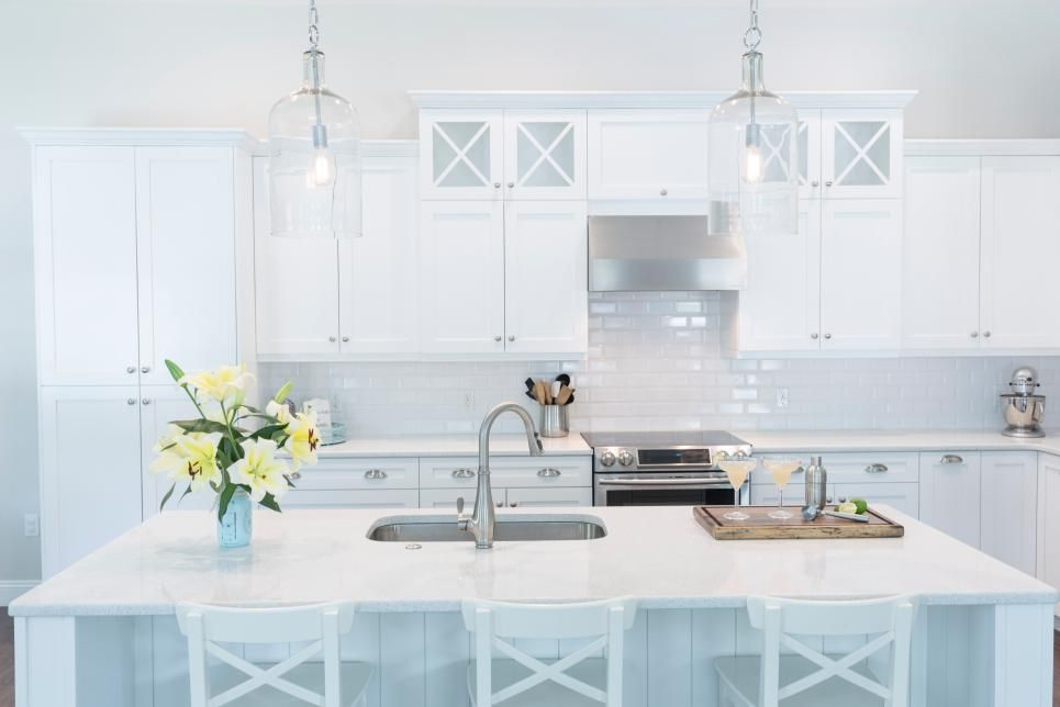 This Coastal Kitchen Is Pristine In All White Shaker Cabinets