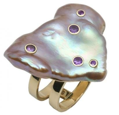 Galatea Ring, a natural color lavender baroque freshwater pearl that is studded with purple Ceylon sapphires and is set in 18K yellow gold.