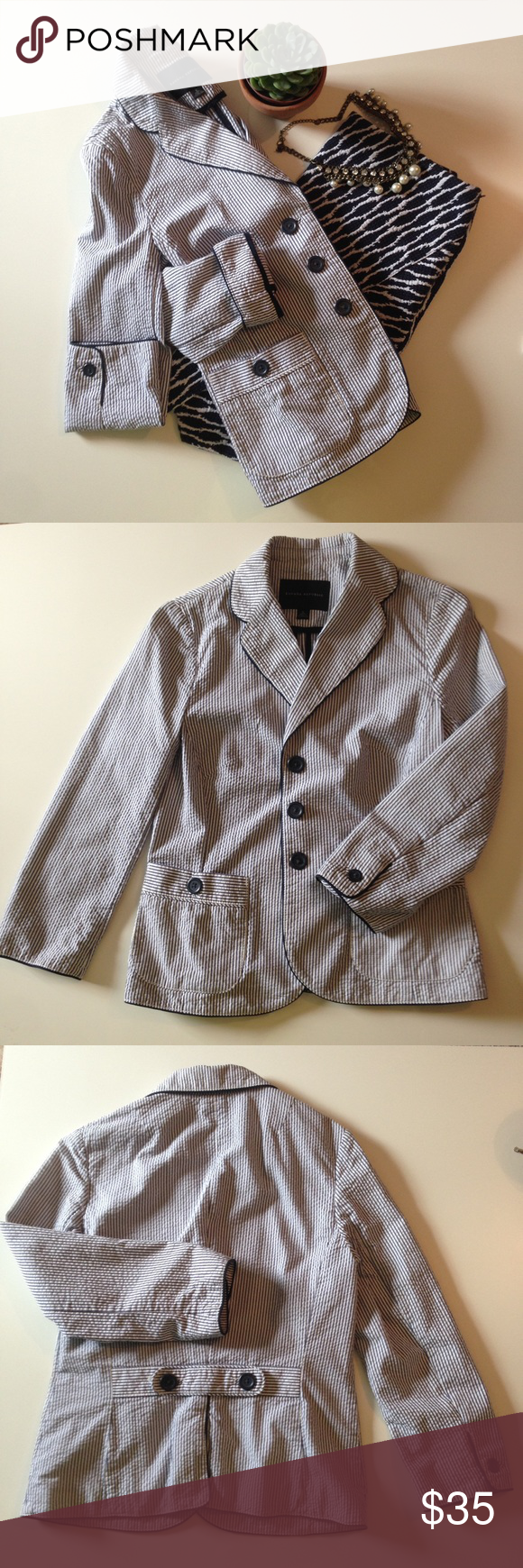 Banana Republic seersucker blazer Classic and stylish navy and white seersucker blazer. 2 pockets in front, 3-button front, button cuffs, button strap in back. Like new. No rips, snags or stains. 100% cotton. Can be machine washed, but I just had it dry cleaned. Adorable with a printed skirt in navy and white, with jeans and leopard print flats, or with white shorts and camel colored sandals. Banana Republic Jackets & Coats Blazers