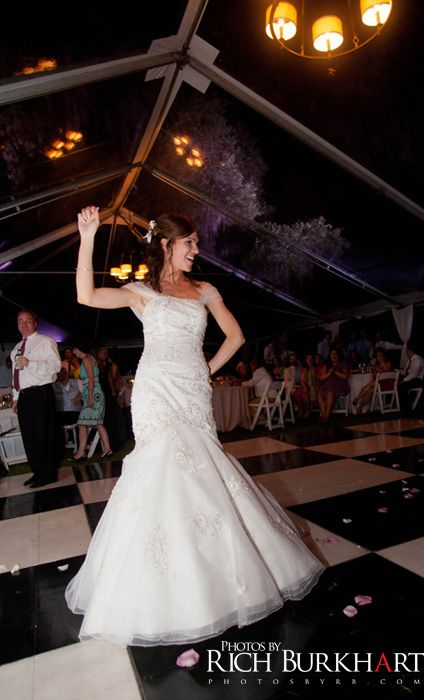 Bride enjoying her reception at the Rose Hill Mansion. Bluffton, SC