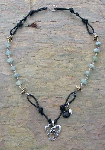 (http://www.elizabethplumbjewelry.com/swirling-heart-and-aquamarine-necklace/)