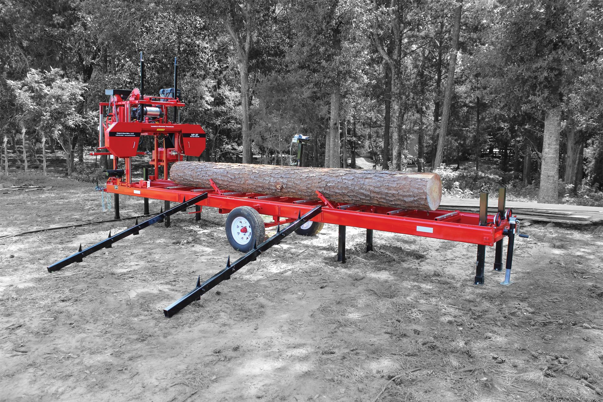 Cooks MP32 portable sawmill loaded with a pine log | Portable