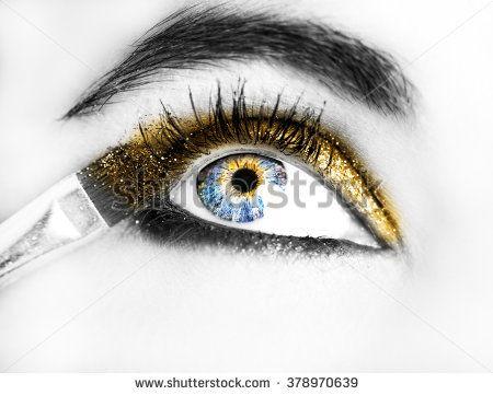 Eye Makeup. Beautiful Eyes Glitter Make-up. Holiday Makeup detail.   - stock photo