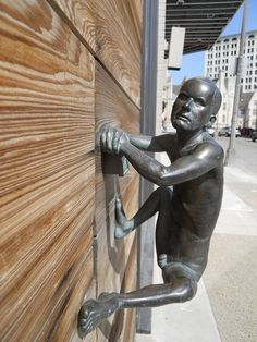 A Weird Crawling Man Door Handle.