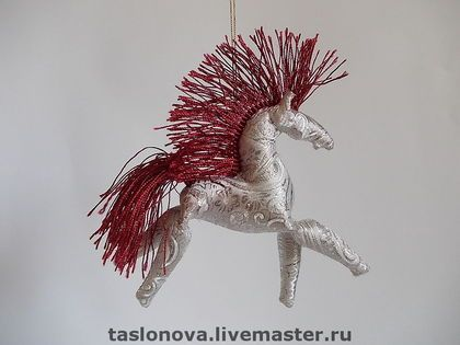 Toy horse by Tanja Slonova.
