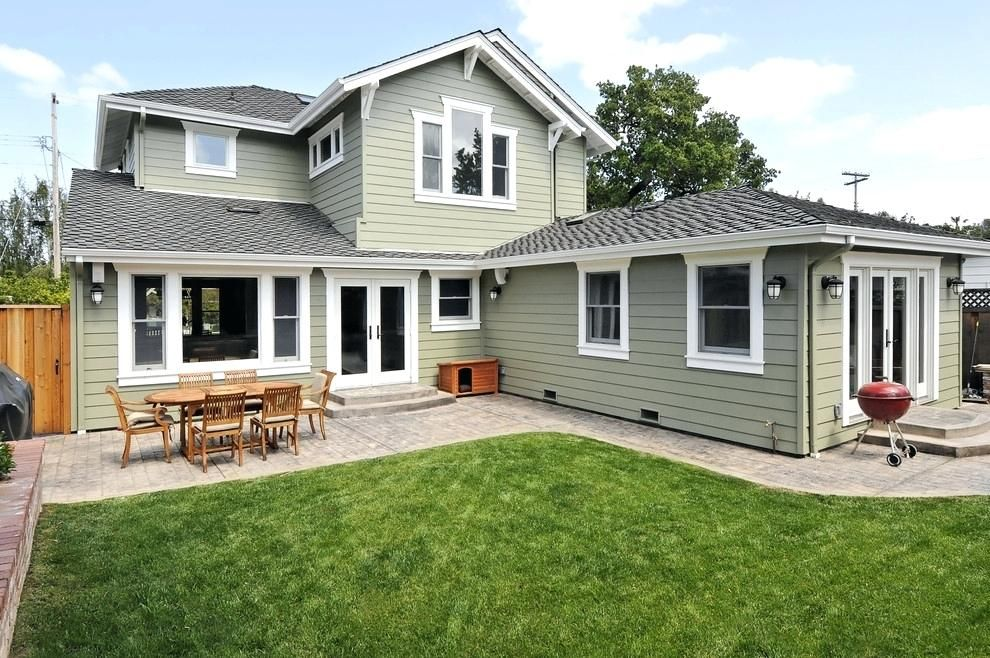 Craftsman style exterior wood doors with brick one story