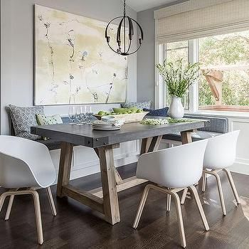 Gray Dining Nook With Salvaged Wood And Concrete Dining Table