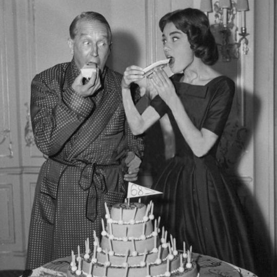 """Audrey and Maurice Chevalier for his birthday on the set of """"Love In The Afternoon"""", 1957"""