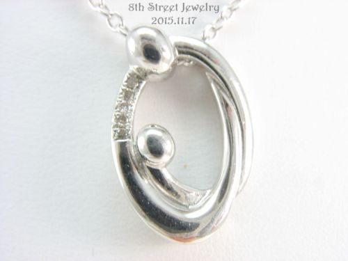 Gabriel co sterling silver 925 diamond mother child pendant necklace gabriel co sterling silver 925 diamond mother child diamond necklacesdiamond jewelrygabrielpendant aloadofball Image collections