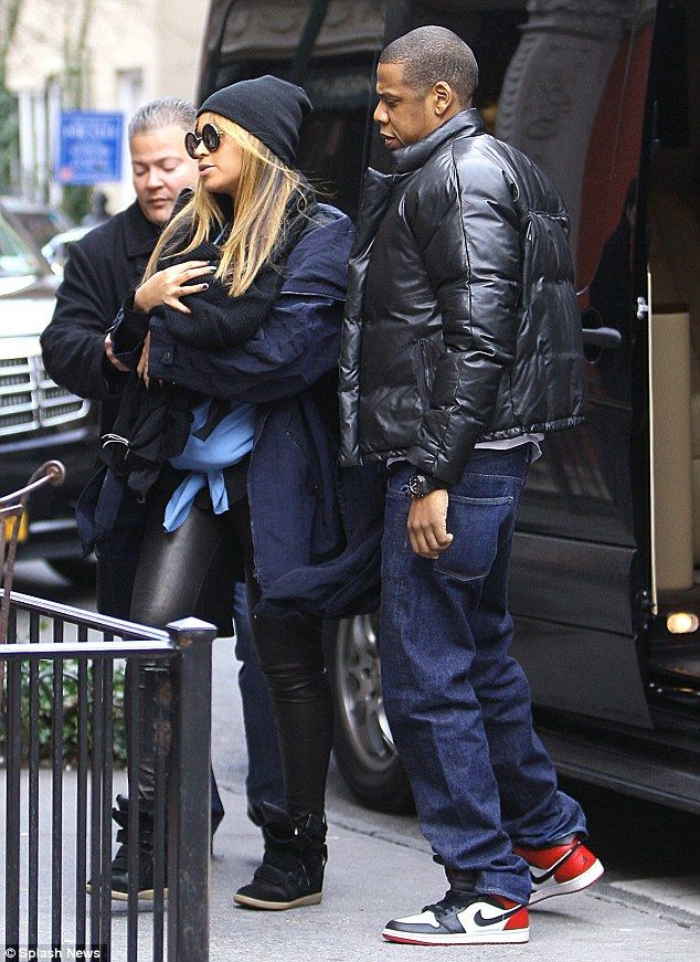Precious cargo on board: Beyoncé cradles baby Blue Ivy as she and Jay-Z  step out with their daughter publicly for first time