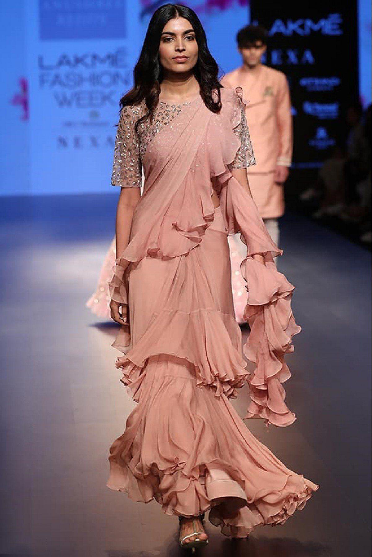 Youdesign Satin Georgette Multi Work Ruffle Saree In Pastel Peach Colour Stylish Sarees Saree Trends Saree Styles