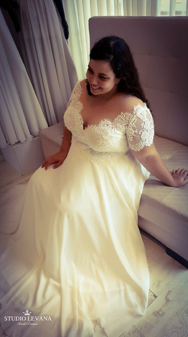 Real bride in a plus size vintage gown with short sleeves scarlet