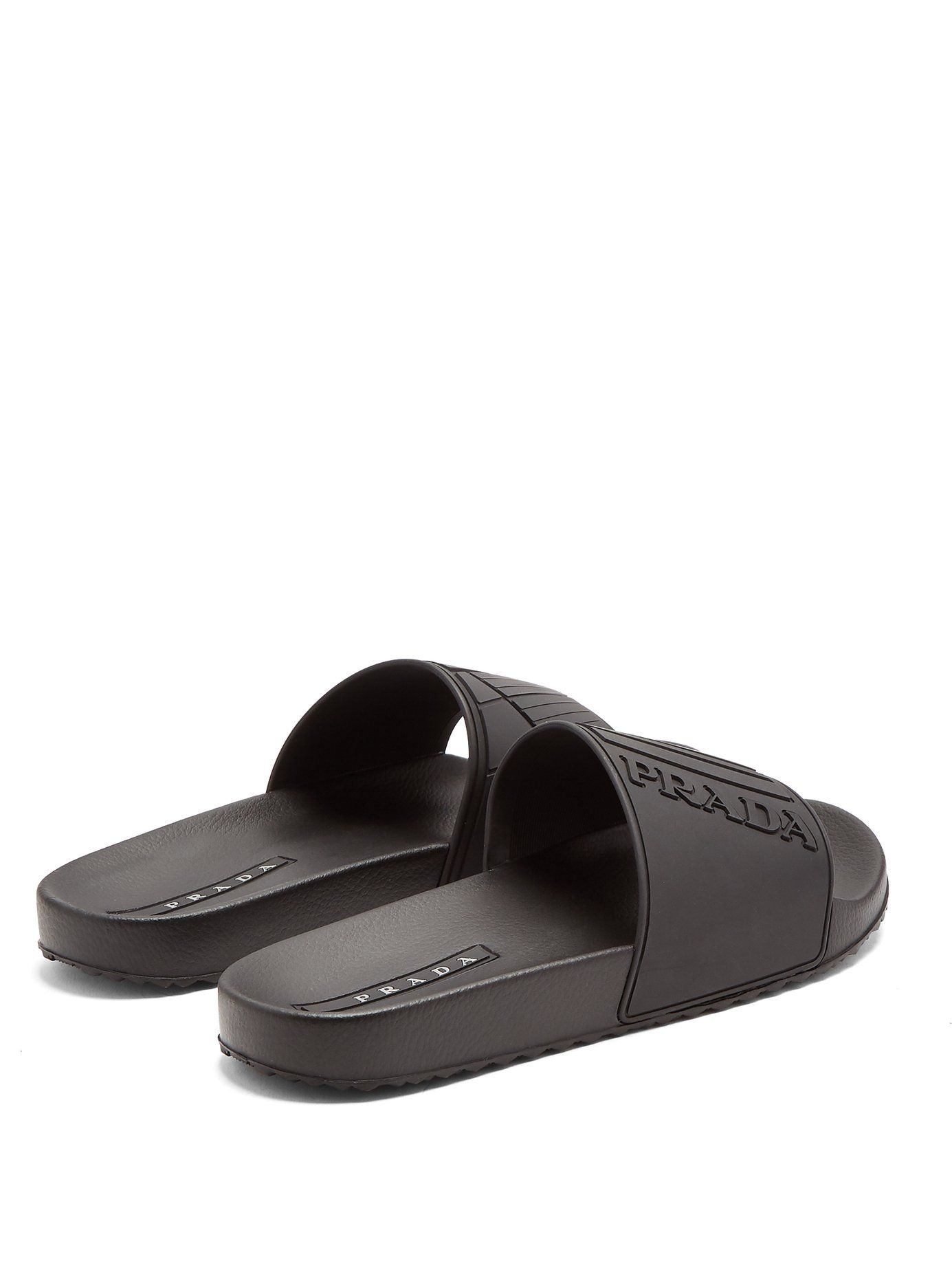Click here to buy Prada Logo-embossed rubber pool slides at  MATCHESFASHION.COM bed9863332d