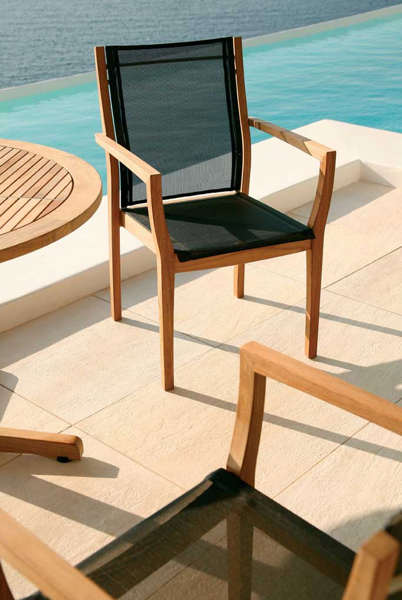 Barlow Tyrie Horizon Stacking Armchair Sling Comfortable