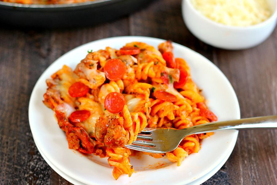 This One Pan Pizza Bake contains all of the classic pizza flavors packed into a one pan meal that is sure to satisfy your cravings. Filled with tender pasta, spicy sausage, lean pepperoni, and topped with cheese, this meal is sure to be a hit with everyone!
