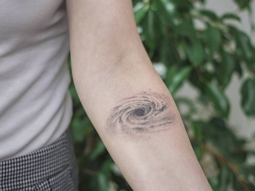 Hand Poked Galaxy Tattoo On The Left Inner Forearm Tattoo