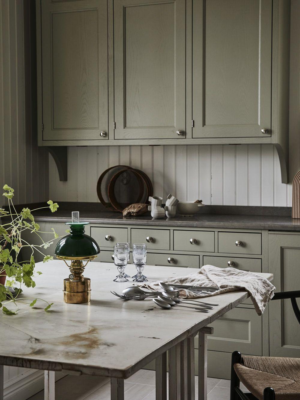 Kitchen sage cabinets white headboard backsplash white table