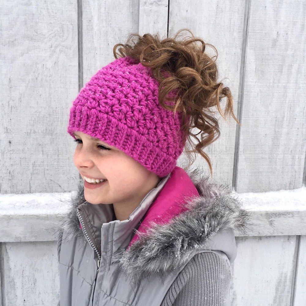 This is a PDF crochet pattern for a beanie with a hole in the top to ...