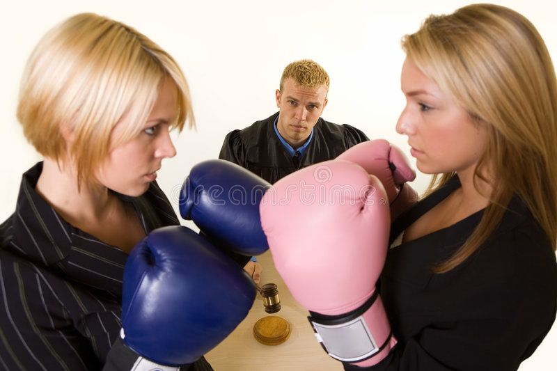 Court battle Two women lawyers wearing boxing gloves facing each other with a j